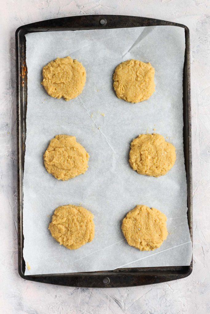 Biscuits on baking sheet before going into the oven.