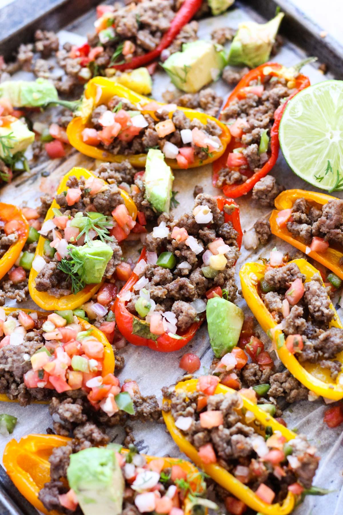 Pepper nachos on a baking sheet.