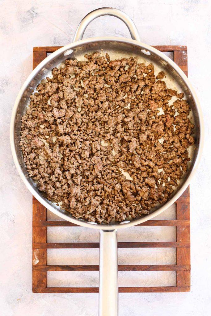 Meat mixture in frying pan.