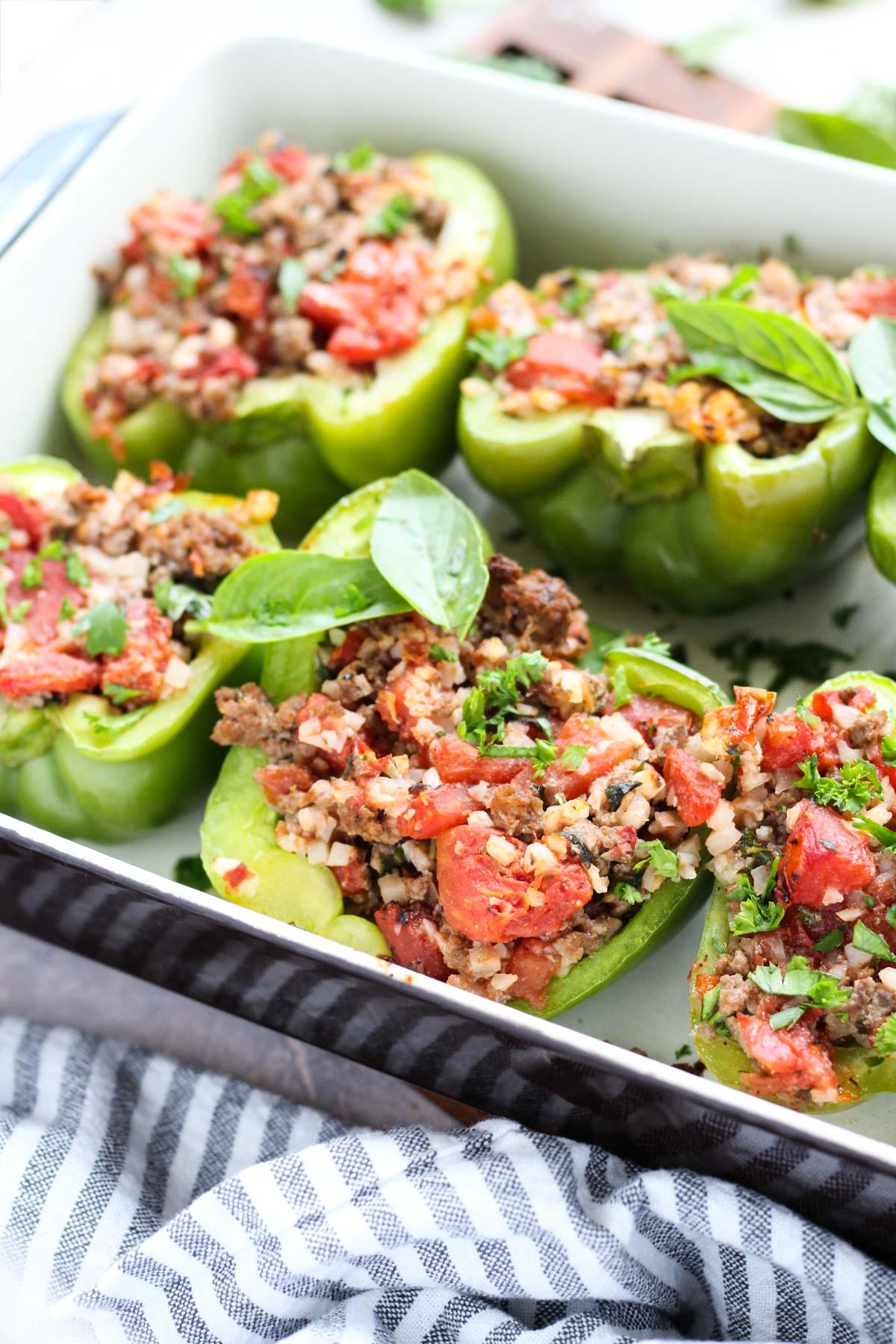 Stuffed peppers in a casserole dish.