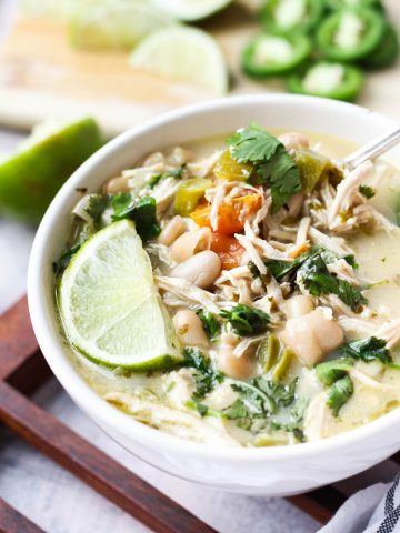Close up shot of white chicken chili in bowl.