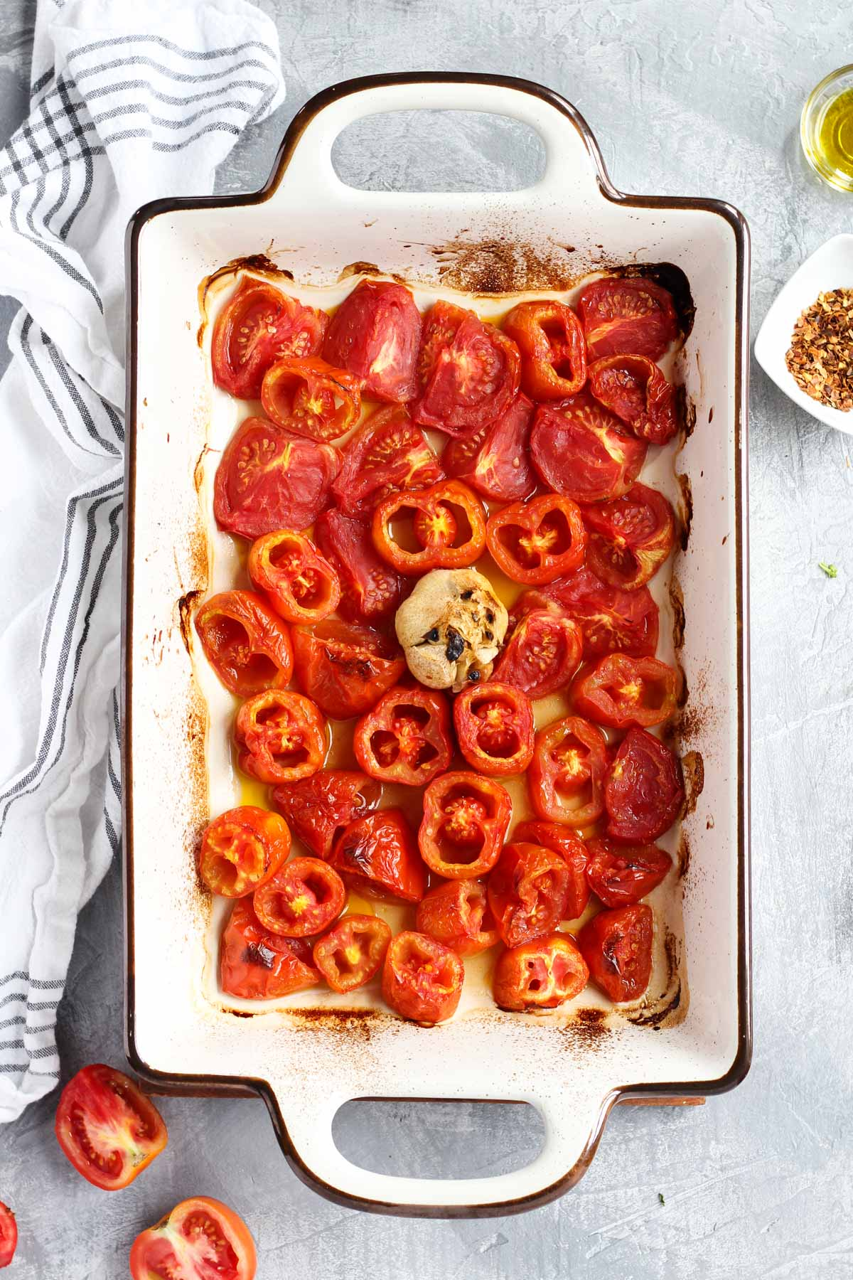 Roasted tomatoes and garlic in a pan.