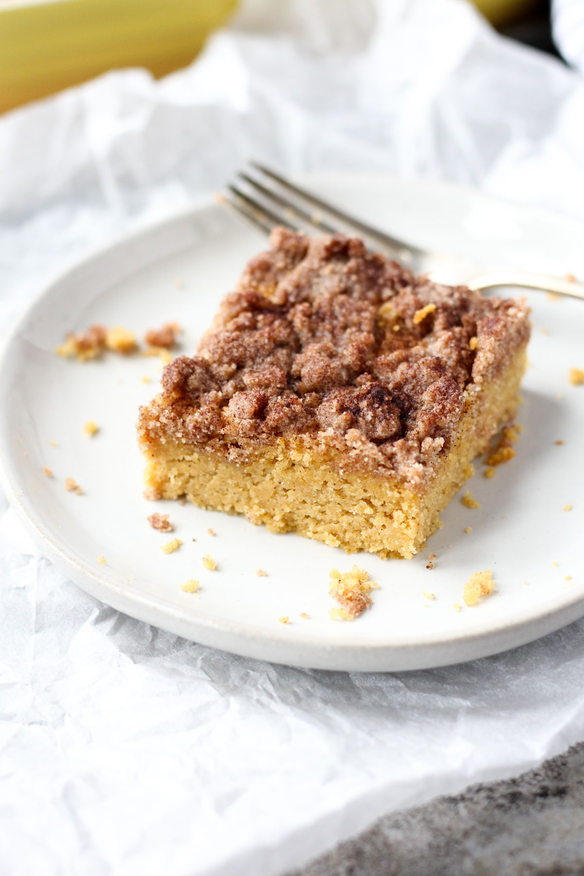 Slice of coffee cake on a white plate.