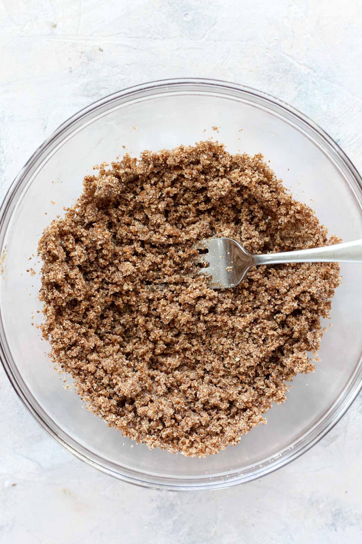 Bowl of cinnamon sugar crumble topping.