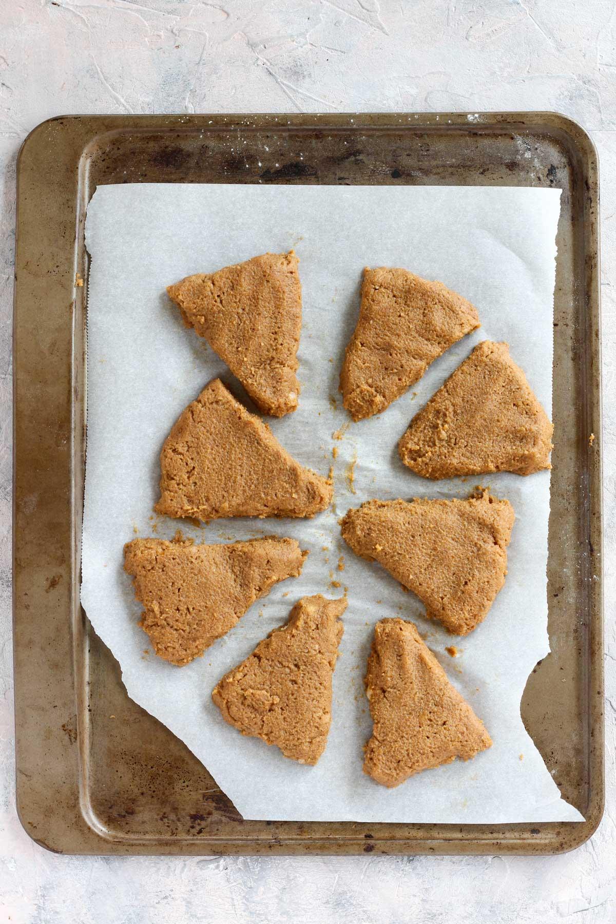 Overhead shot of uncooked scones on baking sheet.