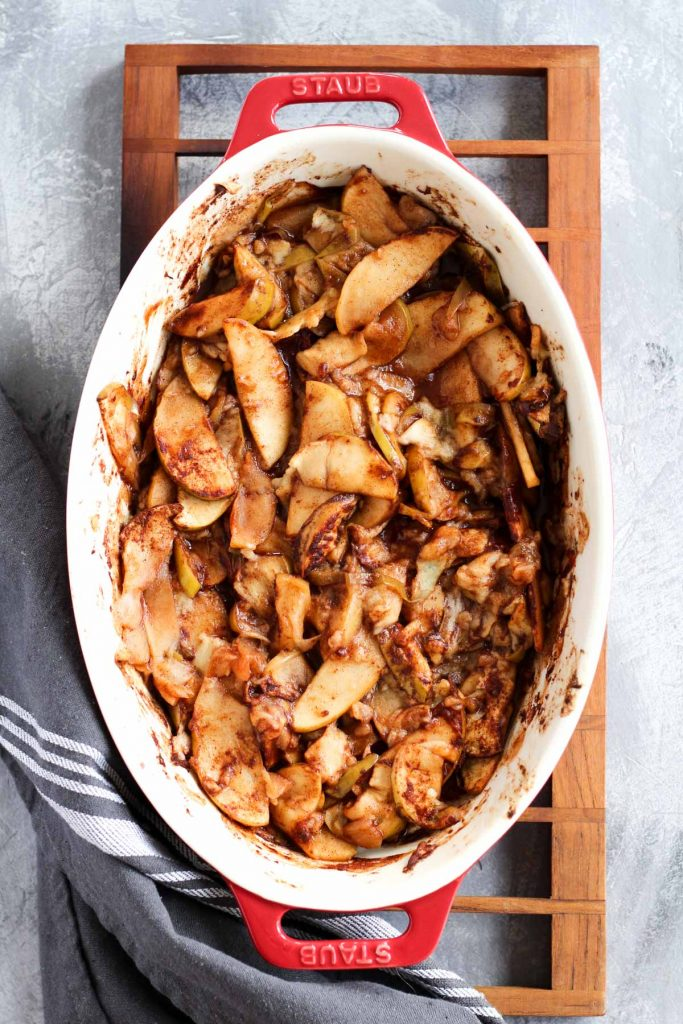 Baked apples in casserole dish.