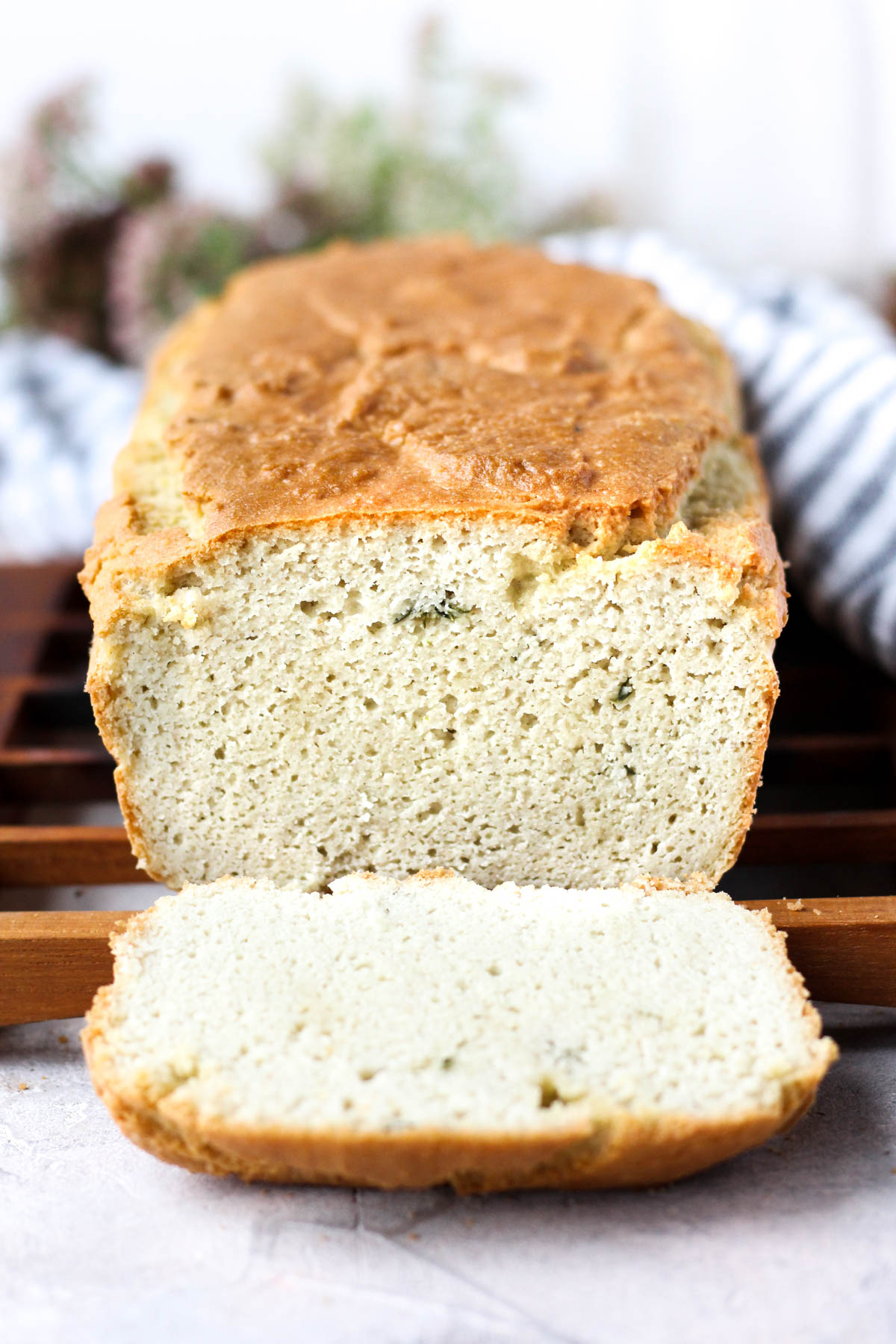 Head on shot of garlic herb loaf with one slice cut.